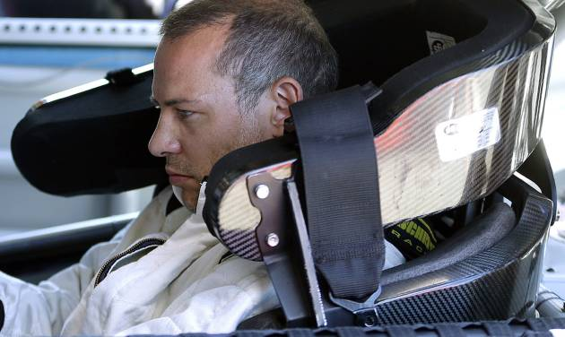 Jacques Villeneuve, of Canada, prepares to take practice laps for the NASCAR Sprint Cup Series auto race on Friday, June 21, 2013, in Sonoma, Calif. (AP Photo/Ben Margot)