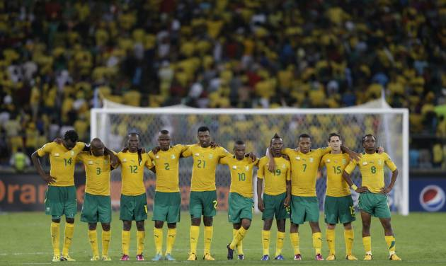 """FILE-In this file photo taken Saturday, Feb. 2, 2013. South Africa players look on during a penalty shoot-out in their African Cup of Nations quarterfinal soccer match against Mali, at Moses Mabhida Stadium in Durban, South Africa. Now, South Africa is nowhere _ not even among the 31 teams that qualified for this year's World Cup in Brazil. Well, not exactly nowhere. It is on FIFA's radar for an investigation into match-fixing allegations. And it is still in the news at home _ for the wrong reasons: Sports minister Fikile Mbalula last month called the national side """"a bunch of losers"""" and """"useless, unbearable individuals"""" after early elimination on home soil from the lower-level African Nations Championship. (AP Photo/Rebecca Blackwell, File)"""