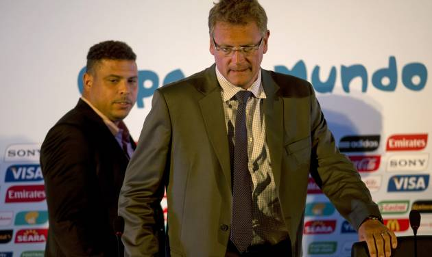 "FIFA's secretary general Jerome Valcke, right, and former soccer player Ronaldo arrive to a press conference in Rio de Janeiro, Brazil, Thursday, Aug 22, 2013. FIFA's secretary general has floated an idea for a possible change to the World Cup bidding process in response to a spate of challenges in organizing next year's tournament in Brazil, which he says has ""clearly"" proven more difficult than in prior host nations. Valcke told reporters at a briefing in Rio de Janeiro on Wednesday he would like to see the highest-level political approvals required as part of the bid package for countries hoping to host future World Cups. (AP Photo/Silvia Izquierdo)"