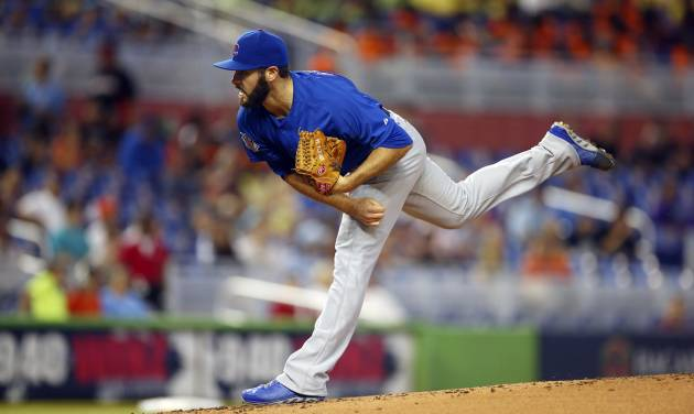 Chicago Cubs starter Jake Arrieta pitches to the Miami Marlins during the first inning of a baseball game in Miami, Wednesday, June 18, 2014.  (AP Photo/J Pat Carter)