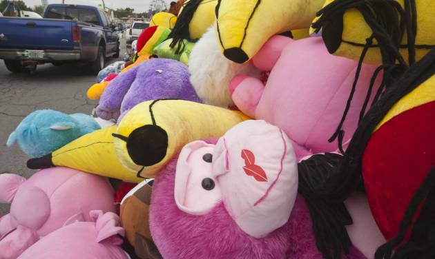 Toy plush animals sit on the midway at the Arkansas State Fairgrounds in Little Rock, Ark., Thursday, Oct. 11, 2012. The fair is scheduled to open Friday, Oct. 12, and run through Oct. 21. (AP Photo/Danny Johnston)