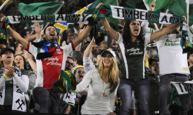 "FILE - In this Sunday, Oct. 13, 2013, file photo, Portland Timbers' fans celebrate the win against Seattle in an MLS Soccer game in Portland, Ore. Legend has it that Portland laid claim to the title ""Soccer City USA"" back in 1975 when the Timbers played their first NASL season. Nearly 40 years later, the city is primed to solidify the moniker as it hosts Major League Soccer's All-Star game. The match Wednesday, Aug. 6, 2014, will pit MLS players from across the league against Bundesliga power Bayern Munich. (AP Photo/Greg Wahl-Stephens, File)"