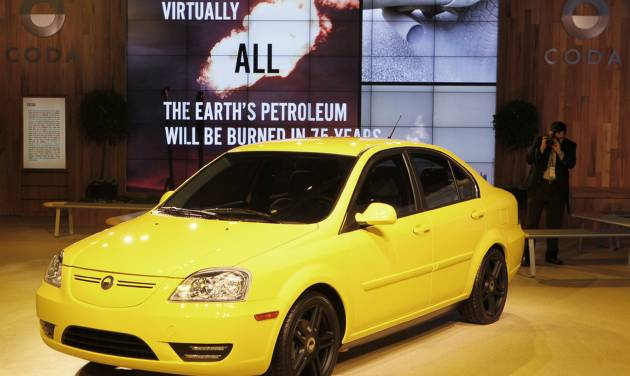 FILE-This Nov. 2010 file photo shows the CODA electric car at the 2010 Los Angeles Auto Show in Los Angeles. The Los Angeles-based electric carmaker CODA Holdings has filed for bankruptcy protection after selling just 100 cars and says it plans to quit the auto business altogether. (AP Photo/Damian Dovarganes,File)