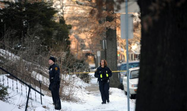 In this Feb. 7, 2014 photo, police investigate the scene were the bodies of sisters Susan Wolfe and Sarah Wolfe were found in the basement of their home in Pittsburgh. The two were sisters of an Iowa state representative, Mary Wolfe. Police said that they are investigating the case as a double homicide. (AP Photo/Pittsburgh Post-Gazette, Rebecca Droke)