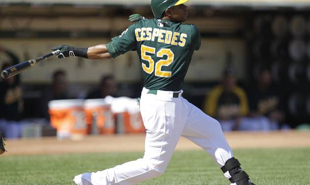 Oakland Athletics' Yoenis Cespedes swings for an RBI triple off Seattle Mariners' Erasmo Ramirez in the first inning of a baseball game Sunday, Sept. 30, 2012, in Oakland, Calif. (AP Photo/Ben Margot)