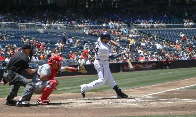 San Diego Padres' Rene Rivera connects for a bloop single with the bases loaded in the first inning of a baseball game against the Cincinnati Reds Wednesday, July 2, 2014, in San Diego. All three men on base scored on the hit.  (AP Photo/Lenny Ignelzi)