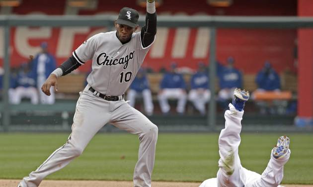 Kansas City Royals' Lorenzo Cain, right, beats the tag by Chicago White Sox shortstop Alexei Ramirez (10) to steal second during the fifth inning of a home opener baseball game Friday, April 4, 2014, in Kansas City, Mo. (AP Photo/Charlie Riedel)