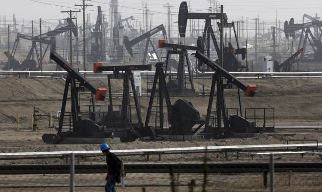 Pumpjacks are shown operating at the Kern River Oil Field in Bakersfield, Calif. [AP Photo]