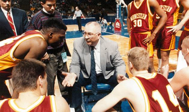 Gerald Stockton, center, coaches Midwestern State. Photo by the Wichita Falls Times Record News