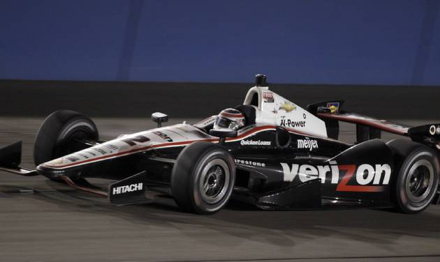 FILE - In this Oct. 19, 2013 file photo, Will Power (12), of Australia, races towards victory in the IndyCar auto race at the Auto Club Speedway, in Fontana, Calif. IndyCar has reached a multi-year agreement with Verizon that will make the telecommunications giant the title sponsor of the series.  Verizon replaces former title sponsor Izod and its sponsorship of what will now be known as the Verizon IndyCar Series launches with the March 30 season opening race. (AP Photo/Alex Gallardo, File)