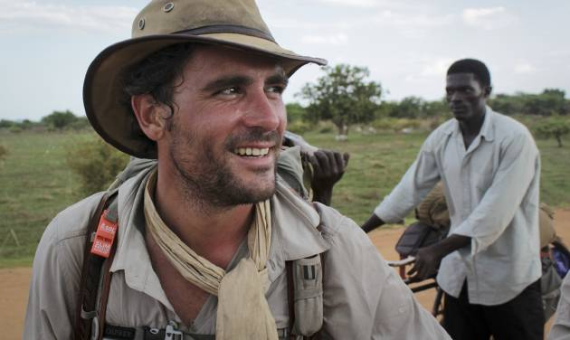 In this photo taken Wednesday, April 9, 2014, former British Army captain Levison Wood sets out walking along the Nile river from Juba, in South Sudan. Close calls with crocodiles and a brutal civil war have not deterred Levison from attempting to walk the length of the Nile, a 4,250 mile journey along the world's longest river that will see him pass through seven countries. (AP Photo/Ilya Gridneff)