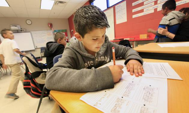 Third-grader Abimael Quinonez, 9, works on a reading exercise Wednesday during intersession at Herronville Elementary School in Oklahoma City. Photo by Paul B. Southerland, The Oklahoman   PAUL B. SOUTHERLAND -  PAUL B. SOUTHERLAND
