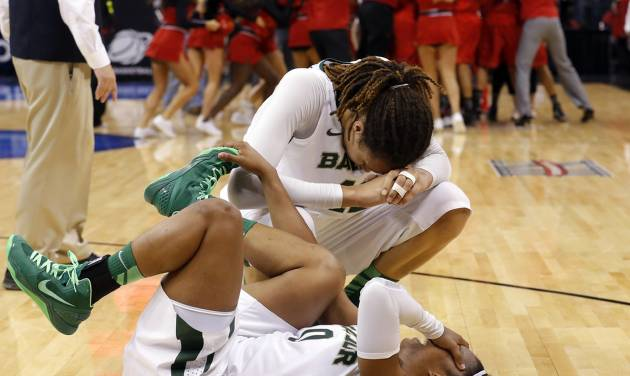 Baylor's Brittney Griner (42) and Odyssey Sims (0) react following their loss to Louisville at the Oklahoma City Regional for the NCAA women's college basketball tournament at Chesapeake Energy Arena in Oklahoma City, Sunday, March 31, 2013. Photo by Sarah Phipps, The Oklahoman