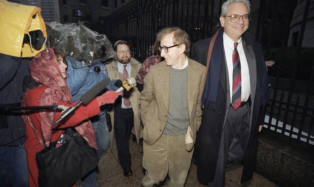 File- This Jan. 12, 1993 file photo shows director Woody Allen trading grins with a pursuing television reporter as he arrives at State Supreme Court in Manhattan, New York, for a hearing in which he requested more liberal visitation rights with his children during his ongoing dispute with ex-lover actress Mia Farrow. Dylan Farrow renewed molestation allegations against Allen, Saturday, Feb. 1, 2014, claiming the movie director sexually assaulted her when she was 7 after he and actress Mia Farrow adopted her. (AP Photo/Mario Cabrera, File)