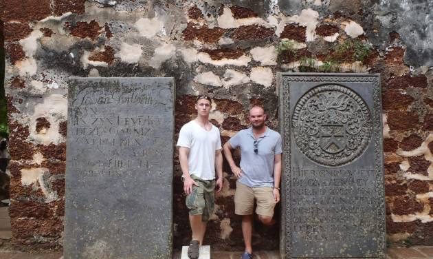 This 2012 photo provided by Jeremy Hanson shows Hanson, left, and a friend, Stephen Conroy, in Malacca, Malaysia, where they hired a private tour guide to take them around. Hanson often hires local guides to give personal tours when he travels. Private tours are a growing industry around the world, no longer the exclusive domain of wealthy travelers.  (AP Photo/Jeremy Hanson, Stephen Conroy)