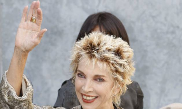 "FILE - In this, Monday, Sept. 22, 2008 file photo, Italian actress Mariangela Melato waves to photographers prior to the start of the Giorgio Armani Spring/Summer 2009 fashion collection, presented in Milan, Italy. Melato, 71, known for her critically acclaimed performance as a spoiled socialite stranded with a sailor she had tormented in the 1974 film comedy ""Swept Away"" has died in a Rome hospital. The Antea hospital said she died Friday, Jan. 11, 2013. The LaPresse news agency said she was suffering from pancreatic cancer. The blonde actress obtained her most success in a series of films in the 1970s directed by the Italian Lina Wertmuller, including ""The Seduction of Mimi"" and ""Love and Anarchy."" (AP Photo/Luca Bruno, File)"