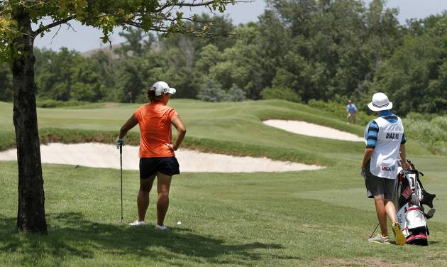 Diaz-Yi and her caddy discuss her options on hitting this ball from the rough. Lauren Diaz-Yi, of Thousand Oaks, CA, won the U.S. Women's Amateur Public Links Championship, needing only  27 holes to secure the victory over runner-up Doris Chen, at the Jimmie Austin OU Golf Course in Norman on Saturday, June 22, 2013.  Photo  by Jim Beckel, The Oklahoman.