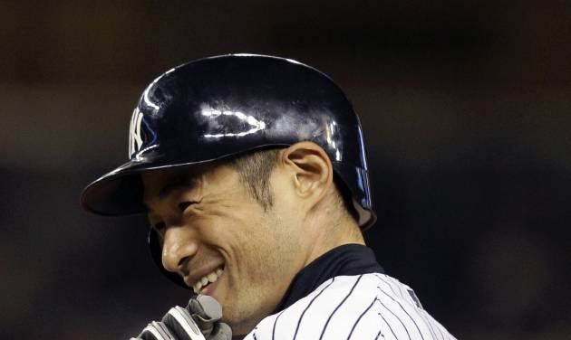 New York Yankees Ichiro Suzuki smiles at first base after driving in the winning run against the Toronto Blue Jays in the eighth-inning of the Yankees' 2-1 victory in Game 2 of a baseball doubleheader at Yankee Stadium in New York, Wednesday, Sept. 19, 2012. (AP Photo/Kathy Willens)