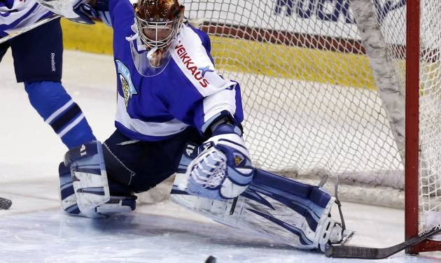 FILE - In this Nov. 8, 2013, file photo, Finland goalie Noora Raty (30) makes a save against the United States during the second period of a Four Nations Cup women's hockey game in Lake Placid, N.Y. Noora Raty was only 15 when she was the starting goalie for Finland's national team in Turin in 2006. Four years later in Vancouver, she led her country to the bronze medal.  (AP Photo/Mike Groll, File)