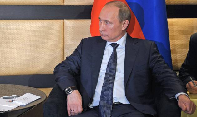 In this photo taken on Wednesday, March 27, 2013, Russian President Vladimir Putin listens to Egyptian President, Mohammed Morsi, unseen, during the BRICS 2013 Summit in Durban, South Africa. Vladimir Putin's spokesman says the Russian president has ordered a surprise military exercise in the Black Sea. Russia's naval affairs are under growing scrutiny due to the civil war in Syria. Russia, a Syrian ally, risks losing access to its naval base in Syria's Tartus port in the Mediterranean Sea if Syrian President Bashar Assad is toppled. (AP Photo/RIA Novosti, Alexei Druzhinin, Presidential Press Service)