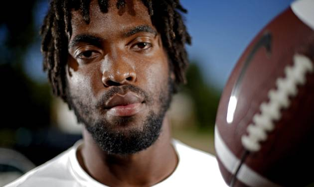 High school football player D.J. Ward poses for a photo at his Lawton, Okla., home on Thursday, July 19, 2012. Photo by Bryan Terry, The Oklahoman