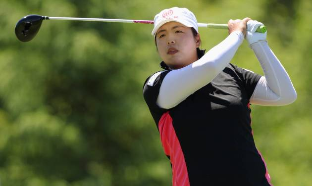 Shanshan Feng watches her tee shot on the fifth hole during the third round of the Manulife Financial LPGA Classic golf tournament Saturday, June 7, 2014 in Waterloo, Ontario. (AP Photo/The Canadian Press, Dave Chidley)