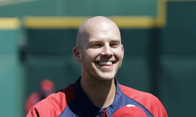 """Cleveland Indians pitcher Justin Masterson tips his hat to fans singing """"Happy Birthday"""" before a spring exhibition baseball game against the Colorado Rockies, Saturday, March 22, 2014, in Goodyear, Ariz. Masterson, who will be the Indians opening day starter, celebrated his 29th birthday Saturday. (AP Photo/Mark Duncan)"""