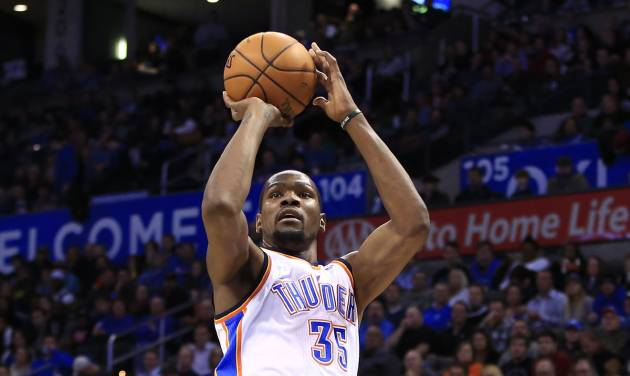 Oklahoma City Thunder forward Kevin Durant (35) shoots over Atlanta Hawks forward DeMarre Carroll during the fourth quarter of an NBA basketball game, Monday, Jan. 27, 2014, in Oklahoma City. Oklahoma City won 111-109. (AP Photo/Alonzo Adams)