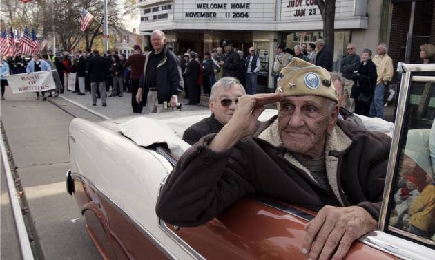 """FILE - This Nov. 11, 2004 file photo shows William """"Wild Bill"""" Guarnere participating in the Veterans Day parade in Media, Pa. Guarnere, one of the World War II veterans whose exploits were dramatized in the TV miniseries """"Band of Brothers,"""" has died, Sunday, March 9, 2014, at the age of 90.  (AP Photo/Jacqueline Larma, file)"""