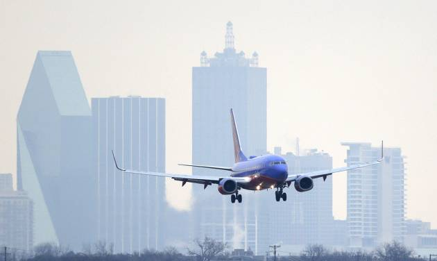FILE - In this Feb. 3, 2014 file photo, a Southwest Airlines jet plane lines up for a landing at Love Field in Dallas. Southwest Airlines reports quarterly earnings on Thursday, April 24, 2014. (AP Photo/LM Otero, File)