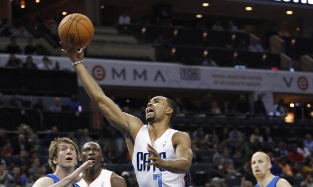 Charlotte Bobcats' Ramon Sessions (7) drives past Dallas Mavericks' Troy Murphy (6) during the first half of an NBA basketball game in Charlotte, N.C., Saturday, Nov. 10, 2012. (AP Photo/Chuck Burton)