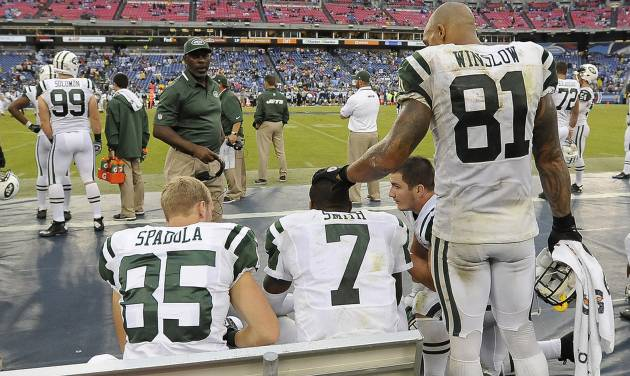 New York Jets quarterback Geno Smith (7) is consoled by tight end Kellen Winslow (81) late in the fourth quarter of the Jets' 38-13 loss to the Tennessee Titans in an NFL football game on Sunday, Sept. 29, 2013, in Nashville, Tenn. At left is wide receiver Ryan Spadola (85). (AP Photo/Mark Zaleski)