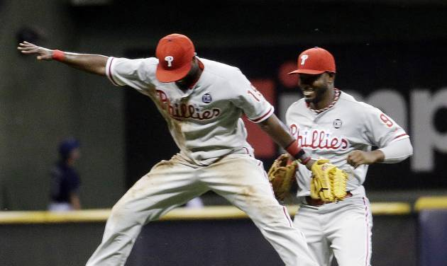 Philadelphia Phillies' Tony Gwynn and Domonic Brown (9) celebrate after a baseball game against the Milwaukee Brewers Monday, July 7, 2014, in Milwaukee. The Phillies won 3-2. (AP Photo/Morry Gash)