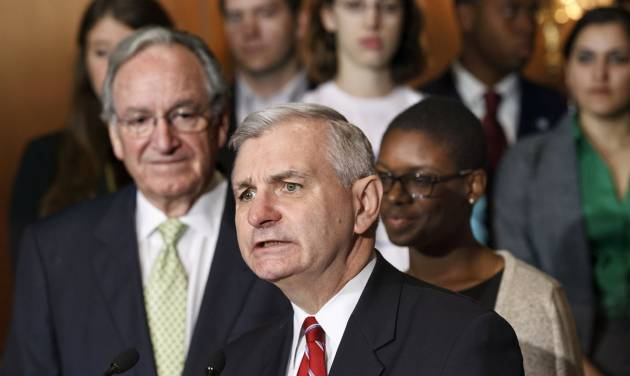 Sen. Jack Reed, D-R.I., center, accompanied by Sen. Tom Harkin, D-Iowa, left, and students, speaks at a news conference on Capitol Hill in Washington, Tuesday, May 8, 2012, as the Senate moves toward a showdown on a Democratic proposal to keep federally subsidized loan interest rates from doubling for millions of college students. Clarise McCants of Philadelphia, right, a Howard University political science major, added her own appeal to the senators. (AP Photo/J. Scott Applewhite)