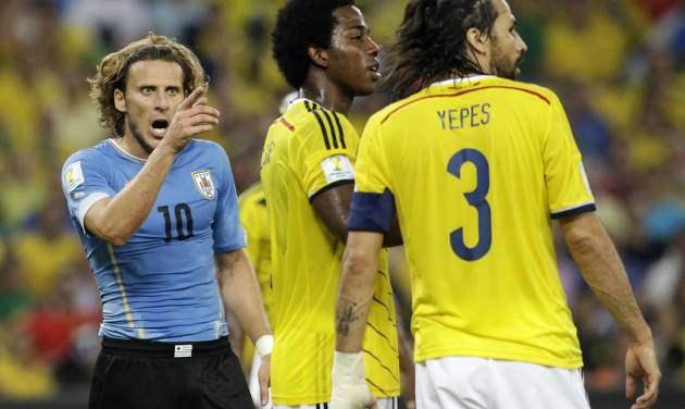 Uruguay's Diego Forlan, left, shouts at Colombia's Mario Yepes during the World Cup round of 16 soccer match between Colombia and Uruguay at the Maracana Stadium in Rio de Janeiro, Brazil, Saturday, June 28, 2014. (AP Photo/Matt Dunham)