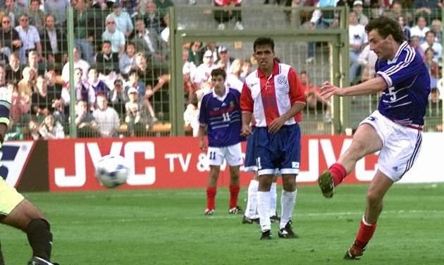 """FILE - In this Sunday, June 28, 1998 file photo,  France's Laurent Blanc scores against Paraguay in extra time of the soccer World Cup second round soccer match, at the Felix Bollaert stadium in Lens, France.  On this day: Blanc scored the first """"golden goal"""" in World Cup finals history to give France a 1-0 win over Paraguay. (AP Photo/Luca Bruno, File)"""