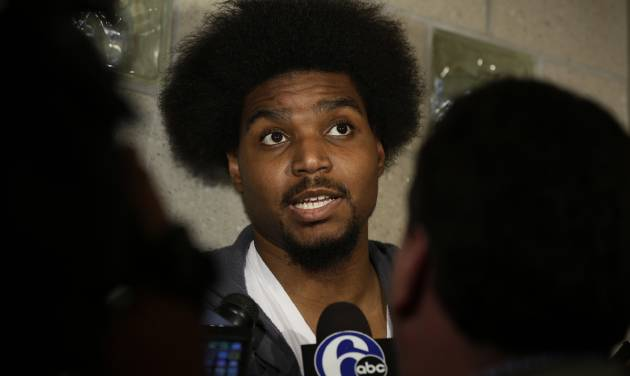 FILE - In this March 1, 2013 file photo, Philadelphia 76ers' Andrew Bynum speaks to members of the media at the team's NBA training facility in Philadelphia. A person familiar with the visit says the Cleveland Cavaliers are hosting free agent center Andrew Bynum.  The 7-foot Bynum, who didn't play one game for Philadelphia last season because of a knee injury, is meeting with team officials Monday, July 8, 2013, said the person who spoke on condition of anonymity because of the sensitivity of negotiations.  (AP Photo/Matt Rourke, File)