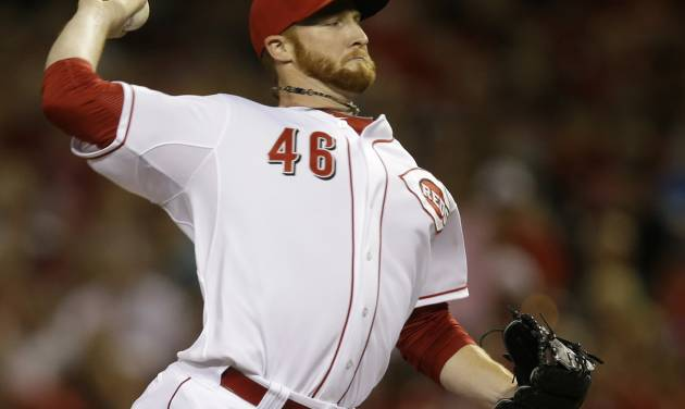 Cincinnati Reds relief pitcher Curtis Partch throws against the Pittsburgh Pirates in the eighth inning of a baseball game, Friday, July 11, 2014, in Cincinnati. Partch was the winning pitcher in the game won by Cincinnati 6-5. (AP Photo/Al Behrman)