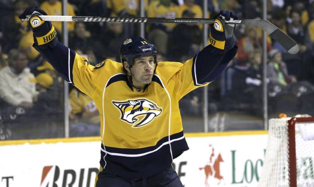 FILE - In this Jan. 12, 2014 file photo, Nashville Predators center David Legwand warms up to play  against the Minnesota Wild in an NHL hockey game in Nashville, Tenn. The Nashville Predators announced Wednesday, Feb. 5, 2014 that they have traded away their first draft pick, sending forward David Legwand back to his hometown Detroit. The Predators got Patrick Eaves, a prospect and a third-round draft pick in exchange for Legwand. (AP Photo/Mark Humphrey, File)