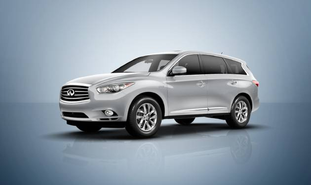 This undated product image provided by Infiniti shows the 2014 Infiniti QX60 Hybrid. This vehicle offers families who need three rows of seats a new roomy and plush sport utility choice. The gasoline-electric hybrid is more than 16 feet in overall length and is rated by the federal government at 26 miles per gallon in combined city/highway travel. (AP Photo/Infiniti)