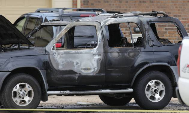 Oklahoma City police and arson investigators are shown at the scene of a vehicle fire Wednesday in Oklahoma City. Officials said a body was found inside the vehicle, but foul play is not suspected. Photo by Paul B. Southerland, The Oklahoman   PAUL B. SOUTHERLAND
