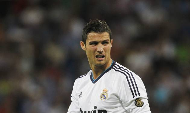 Real Madrid's Cristiano Ronaldo from Portugal reacts after an injury during a Spanish La Liga soccer match against Granada at the Santiago Bernabeu stadium in Madrid, Spain, Sunday, Sept. 2, 2012. (AP Photo/Andres Kudacki)