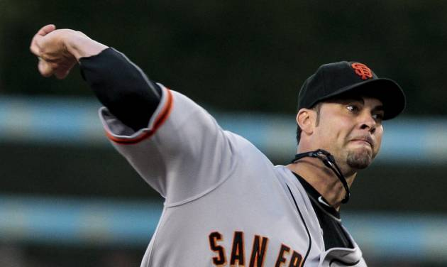 San Francisco Giants starting pitcher Ryan Vogelsong throws to the plate during the first inning of a baseball game against the Los Angeles Dodgers, Tuesday, May 8, 2012, in Los Angeles. (AP Photo/Bret Hartman)