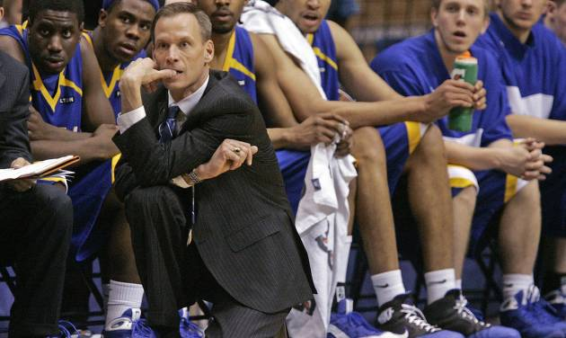 Tulsa coach Doug Wojcik and his team watch the action near the end of 74-55 loss to Auburn during their NIT second-round college basketball game at Beard-Eaves Memorial Stadium in Auburn, Ala., Friday, March 20, 2009.  (AP Photo/Dave Martin) ORG XMIT: ALDM106