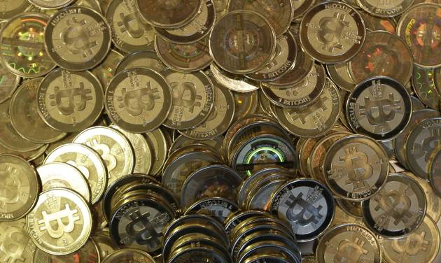 FILE - This April 3, 2013 file photo shows bitcoin tokens in Sandy, Utah.  The website of major bitcoin exchange Mt. Gox is offline Tuesday, Feb. 25, 2014, amid reports it suffered a debilitating theft, a new setback for efforts to gain legitimacy for the virtual currency.  (AP Photo/Rick Bowmer, File)