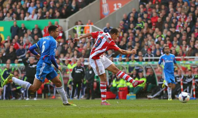 Stoke City's Peter Odemwingie, centre,  scores during the English Premier League soccer match against Hull City, at the Britannia Stadium, Stoke On Trent, England, Saturday March 29, 2014. (AP Photo/PA,  Dave Thompson) UNITED KINGDOM OUT