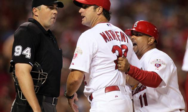 St. Louis Cardinals manager Mike Matheny, center, tries to separate third base coach Jose Oquendo (11) from home plate umpire Lance Barrett (94) after Oquendo was ejected for arguing balls and strikes in the sixth inning of a baseball against the Pittsburgh Pirates on Friday, Aug. 17, 2012, in St. Louis. (AP Photo/St. Louis Post-Dispatch, Chris Lee) Photo by Chris Lee, clee@post-dispatch.com