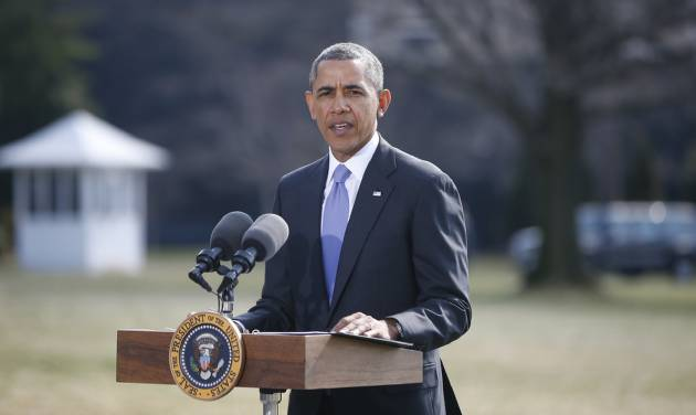 President Barack Obama makes a statement on Ukraine, Thursday, March 20, 2014, on the South Lawn at the White House in Washington before departing for Florida. President Barack Obama said the US is levying a new round of economic sanctions on individuals in Russia, both inside and outside the government, in retaliation for the Kremlin's actions in Ukraine. He also said he has also signed a new executive order that would allow the U.S. to sanction key sectors of the Russian economy. (AP Photo/Charles Dharapak)