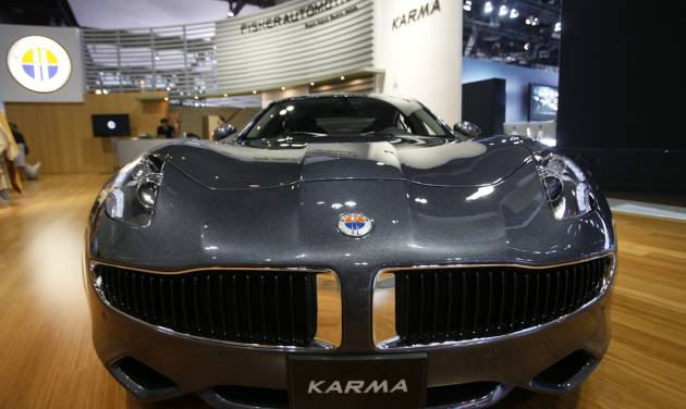 FILE - In this Nov. 18, 2010, file photo, Fisker Automotive's Fisker Karma, a sports luxury plug-in hybrid car, is displayed at the 2010 Los Angeles Auto Show in Los Angeles.  Hybrid Technology, led by Hong Kong billionaire Richard Li, has offered $55 million in an auction of Fisker Automotive's assets, just days after a bankruptcy judge in Delaware rejected Hybrid's plan to take over the failed electric-vehicle manufacturer in a private sale. (AP Photo/Damian Dovarganes, File)