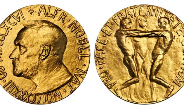 This undated photo provided by Stack's Bowers Galleries shows both sides of a Nobel Peace Prize that was saved from possible destruction for the value of its gold. The 1936 medal is only the second Nobel Peace Prize to come to auction and marked the first time an individual from Latin America was recognized by the prestigious award. The 23-karat relic is being offered for sale in Baltimore on March 27, 2014, by the New York-based Stack's Bowers Galleries. (AP Photo/Stack's Bowers Galleries)